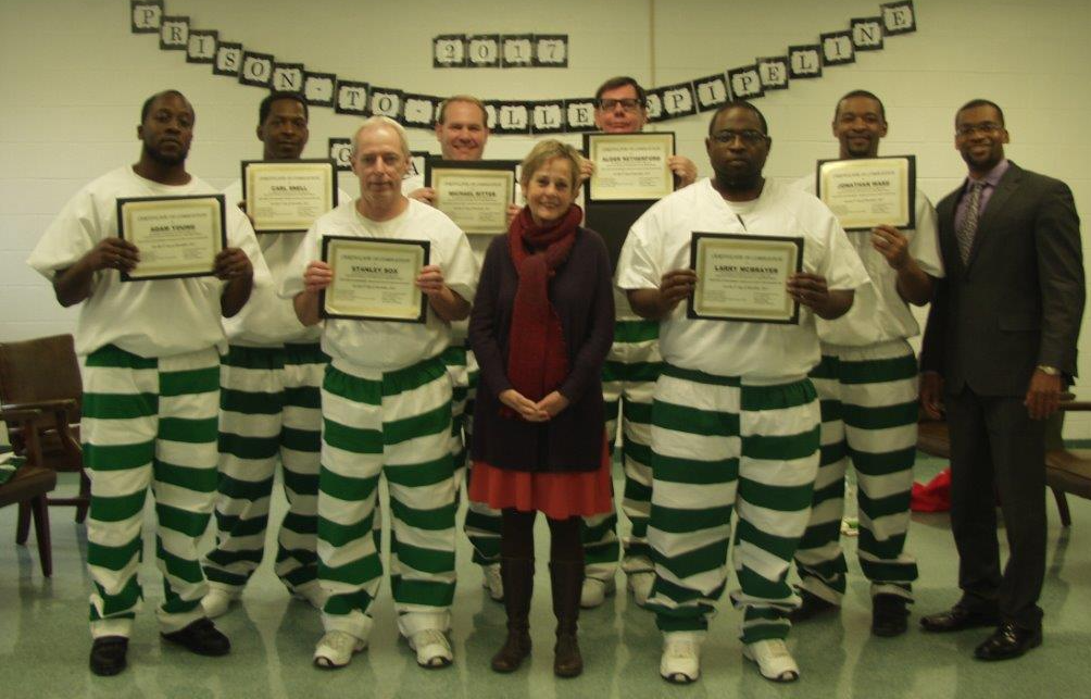 Dr. Fisher-Wirth (middle) and Dr. Alexander (right) and students in the UM Prison-to-College Pipeline Program.